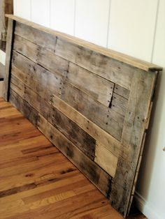 Pallet headboard, I guess I need a separate board for just pallet inspirations since I am developing this obsession with it...I know it's a little more simple than the wood inspirations you had in mind but I  think pallet furniture is cool so far i haven't seen anyone painting or staining them so that is where my work would differ...