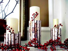 candle holders made using cans covered with birch print paper