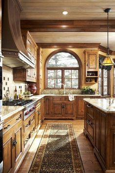 I like how the ceilings are light wood with dark wood trim..