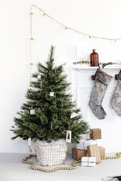 DIY Tree Skirt Alternative Weihnachten<br> The Merrythought Best Christmas Tree Stand, Small Christmas Trees, Noel Christmas, Christmas Bedroom, Christmas Tree Basket Skirt, Alternative To Christmas Tree, Christmas Quotes, Minimal Christmas, Modern Christmas