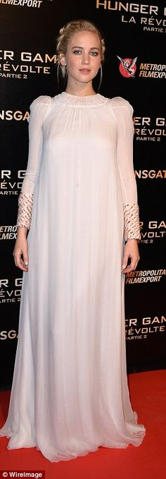 Leading lady: The franchise star chose another stunning dress from Dior for her latest red...