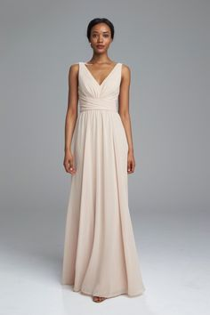 4b16024062 V-neck bridesmaids dress with double strap and criss cross waist from  Amsale Bridesmaids.