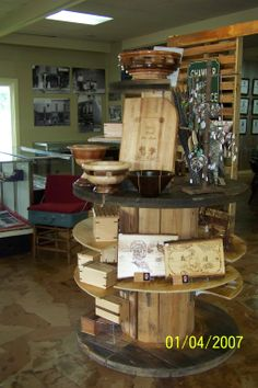 Cave City Welcome Center Old wooden spools used to make shelving. Suitcase Display, Cave City, Wooden Spools, Firewood, Shelving, Home, Shelves, Woodburning, Ad Home