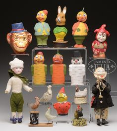 FABULOUS LOT OF 15 GERMAN CANDY CONTAINERS. - by James D. Julia