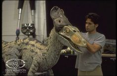 Special Effects Character Creator Christopher Swift makes final adjustments to one of JURASSIC PARK III's animatronic dinosaur puppets before final latex skin gluedown.