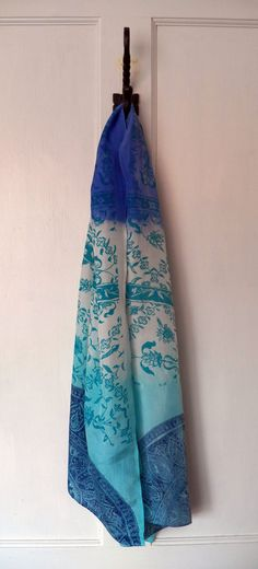 Hand dyed and screen printed blue silk scarf with ethnic pattern by Holly Eden