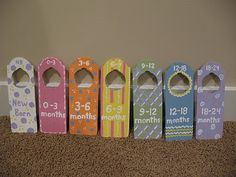 Kids clothes dividers. A little paint and $.79 door hangers from the craft store.