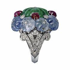 CARTIER. Ring - platinum, carved emerald, sapphires, rubies, brilliant-cut diamonds. #Cartier #L'OdyséeDeCartierParcoursD'unStyle #2013 #HauteJoaillerie #HighJewellery #FineJewelry #TuttiFrutti #CarvedStones #Emerald #Ruby #Sapphire #Diamond