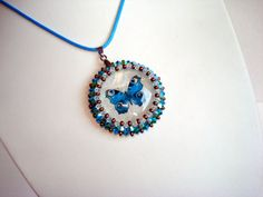 Handmade pendant with glass lens swarovski bicone and por Beabead