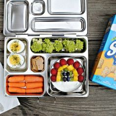 lunchbox open with spoon picnic table