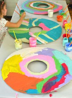 five-year olds paint and collage cardboard donuts