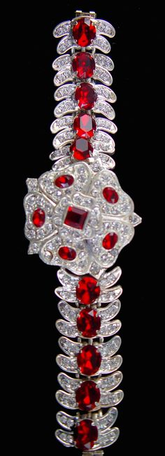 Rose of York Bracelet ~ When Princess May of Teck married the Duke of York in 1893, she was given a number of jewels in the shape of the rose of York.  One present, a ruby and diamond pendant with a square ruby centre was given to her by the Duke himself.