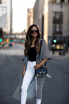 40800dcf1146 fashion blogger mia mia mine wearing a striped top and a prada cahier bag -  Prada