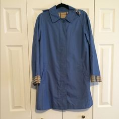 Authentic Burberry blue hooded trench coat Amazing condition authentic Burberry trench coat size 6 detachable hood with signature hood color and sleeves Burberry Jackets & Coats Trench Coats