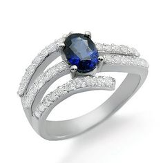 This shimmering sapphire diamond gemstone ring has a 0.83ct oval shaped sapphire main stone in a prong setting. There are  diamonds in prong settings with a total weight of 0.47cts. The color and clarity are G/H and I1/I2 respectively. $772.00