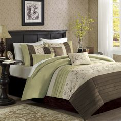 The Serene bedding collection provides an elegant look to your home. The top of the duvet cover is a mix of soft sage, chocolate brown, and ivory with piecing details while the ivory section has an embroidered floral pattern for a soft divide from these bold colors. Made from polyester dupioni, this fabric will produce a shine and pick up the light on both the duvet cover and shams. The decorative pillows come in a combination of solids, stripes, and embroidery to pull this whole set…