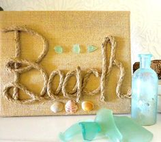 Beach Art DIY Burlap Canvas with Rope Font is part of Beach crafts Canvas - Here is a simple and lovely beach art project using a burlap canvas, rope font and beach finds by 2 Bees in a Pod Sea Crafts, Rope Crafts, Seashell Crafts, Nature Crafts, Burlap Canvas, Diy Canvas, Burlap Art, Canvas Art, Rope Font
