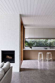 "Rob Kennon Architects' Brighton House takes its cues from the coastal location in the Melbourne suburb of Brighton, uniting a traditional palette with contemporary design to create spaces of controlled openness and retreat. The Brighton House creates an interplay of ""some very large, open spaces, and hidden retreats throughout"", says Rob Kennon."