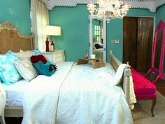 Turquoise & white bedroom with touches of hot pink