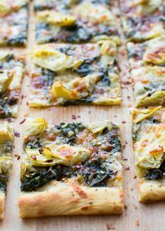 Spinach and Artichoke Sheet Pan Pizza! You just need one ball of pizza dough, jarred artichokes, wilted spinach, and CHEESE! Easy weeknight meal and great for a crowd.