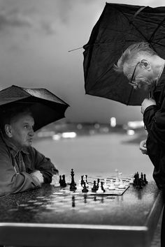 Despite all - I walked on a cloudy day Vistula boulevards and I was shooting. Suddenly it began to rain, so I quickened my pace. Then I saw that older men despite the bad weather didn't stop playing chess. Had been established between us  a short discussion about their passion, the rules, the place we have stayed in. The situation has resulted in finding an old board game and is played few games.