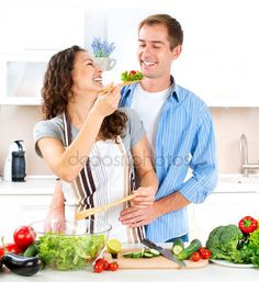People Stock Images , People Pictures , person photo , - Happy Couple Cooking Together. Dieting. Healthy Food