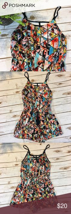 """Colorful Xhilaration Romper Adorable, colorful romper by Xhilaration- perfect for summertime!! Front of romper does have black tie accent. Straps on back of romper come together to make a cute design. Interior tag shows """"100% rayon""""             Measurements approximately:                                                     Armpit to Hem: 20 inches Xhilaration Pants Jumpsuits & Rompers"""