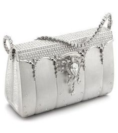The most expensive handbag encrusted with 2,182 Diamonds & Platinum. Valued at $1,900,000.00
