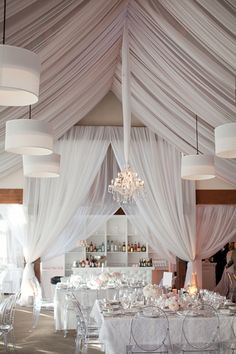 beautiful tent draping - love the tulle wrapped chandelier cord