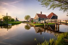 This peaceful image shows a classic representation of a Dutch village. The windmills add a touch of whimsy while their linear structures contrast nicely with the bowed bridge on the right. Add in absolutely still water for perfect reflections, quaint buildings, and ideal lighting, and you've got the makings for one top-notch Inspirational Photo of the Day! Congrats to photographer Luigi Trevisi for a stunning image!
