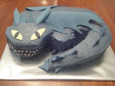 For a birthday party. Supposed to be Night Fury from How to Train Your Dragon. Only problem was, the cake was due the same day as the movie premier, and there were very few pictures on the net at the time. Overall, I was happy with this cake. Dragon Birthday Parties, Dragon Party, Boy Birthday, Birthday Ideas, Toothless Party, Toothless Cake, Dragon Cakes, Homemade Birthday Cakes, Elmo Party