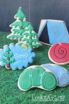 CookieCrazie: camping set. Love the sleeping bag, blue tent, trees & torch.