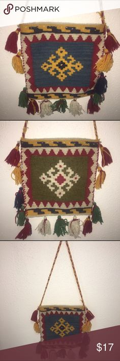 Woven Bohemian tassel bag S. American influence This bag appears to be Hand woven been in has no brand. One side features a blue background and the other side features cream with pom-pom tassels. This bohemian Gem fits neatly under your arm or can be worn as a cross body. Perhaps South American or African design.  Material is wool or wool blend. Did you know that you can save a significant amount of money when you purchase. 3-5 items from my closet? One shipping charge and a percentage off…