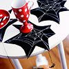 Creepy Spider Coasters  Set a spooky Halloween table with these spiderweb coasters made from black crafting foam and white tube-style paint -- don't forget to add the almost-lifelike hanging spiders!