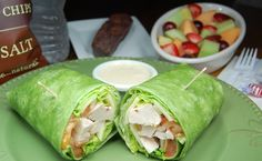 grilled chicken caeser wrap. chicken breast strips romaine lettuce, aged shredded parmigiano cheese tomato slice in a spinach flour tortilla with ceaser dressing.