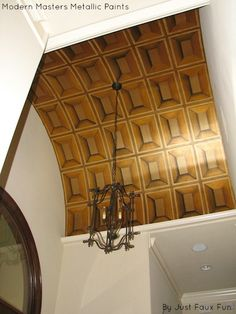 A Trompe l'eoil paneled arched entry ceiling using Modern Masters golds and bronzes   By Just Faux Fun