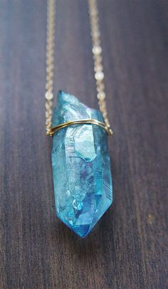 Intense Blue and Sparkly.    Featuring a beautiful natural aqua aura crystal druzy mineral gemstone which was hand framed into a 14k gold filled