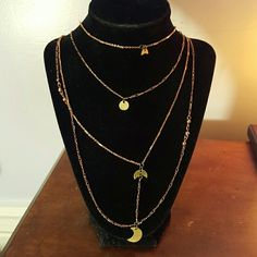 Free people rose gold 4 layer necklace $38 NWOT Delicate rose color gold chains with antiqued gold charms. Free People Jewelry Necklaces