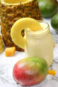 Blend up this recipe for a delicious tropical breakfast smoothie with mango, coconut milk, pineapple, and no banana-a healthy, easy, fruit-filled way to start the day! Vegan, Paleo, Dairy-Free, No added Sugar.