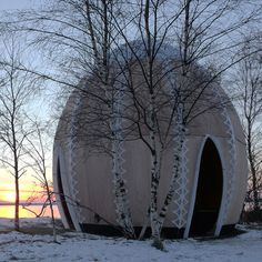 An open fire welcomes visitors to this egg-shaped hut built by Danish studio SHJWorks on the edge of a Copenhagen park