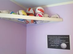 My husband made this awesome shelf to display all of volleyballs that our daughter just can't give up! Some of them are all played out!
