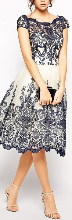 embroidered lace dress. so beautiful. i'd wear this to a wedding in a heartbeat.
