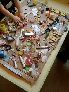 "Putting glue to good use as children learn to work with it. The ""glue table"" becomes a beautiful work of collage!"