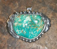 Large half of a Kingman Arizona turquoise nugget.   This is before I set the edges if the bezel...The feathers are each totally hand made and the little silver balls are individually made also..no pre made parts at all
