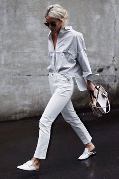Blue stripe shirt, white crop straight jeans, white mule flats, black aviator sunglasses and a black top handle bag. Simple summer outfit, casual summer outfit, simple outfit, summer outfit, minimal style, minimal outfit, wear to work, casual friday, #summervibes #summerstyle #fashion2018 #fashiontrends2018 #casualstyle #streetstyle #stylish #minimalist #minimalstyle #whitejeans