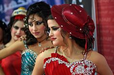March 5, 2012 Israeli-Arab models line up on stage during a beauty pageant and hair styling contest in the West Bank city of Jenin. More than 100 Palestinians, Israeli Arabs and Golan residents took part in the pageant. Mohammed Ballas/AP