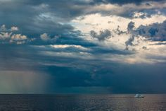 Out of Danger by Matthew John George on Capture Wisconsin // After years of experience observing the weather patterns along the Great lakes, I have given myself the gift of being able to find drama there, especially when the boats come in racing a warm weather squall.  photographed from Milwaukee's breakwater.