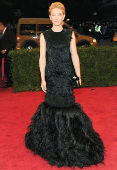 Cate Blanchett in a feathered black Alexander McQueen gown. #MetGala