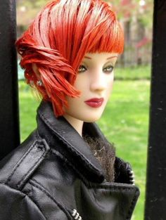 About Leather Juxtaposed: Side view Outside Springtime.Antoinette models Juxtaposed fashion. Hairstyle was wet, moussed and finger combed and twisted into its style. Leather motorcycle jacket belongs to another doll.