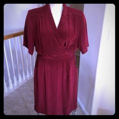 """Vintage maroon silk dress Size 14, but please see measurements, vintage sizes can run smaller. Still in good condition with lots of life left! No tears or stains. Shoulder pads can be easily removed if you don't want them. Front pockets. Button and snap button closures in front of dress. Small slit in front. 100% silk. 17"""" shoulders 40"""" bust 31"""" waist 46"""" hips Dresses"""